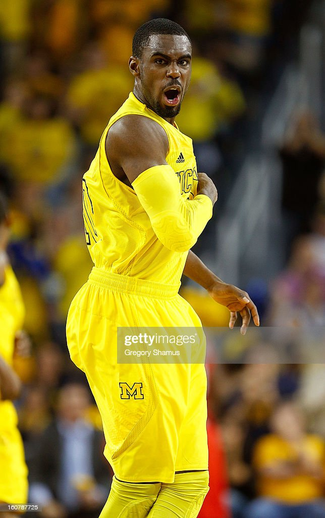 Tim Hardaway Jr. #10 of the Michigan Wolverines reacts after a three point basket while playing the Ohio State Buckeyes in the second half at Crisler Center on February 5, 2013 in Ann Arbor, Michigan. Michigan won the game 76-74 in overtime.