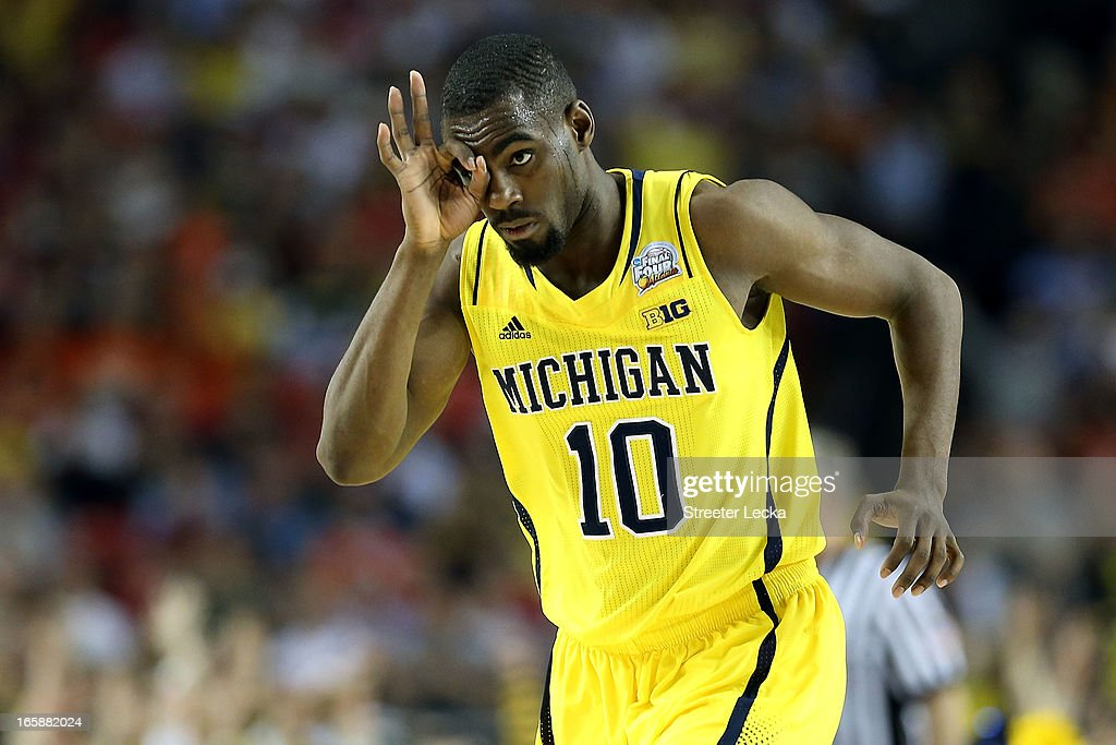 Tim Hardaway Jr. #10 of the Michigan Wolverines reacts after he made a 3-point shot in the second half against the Syracuse Orange during the 2013 NCAA Men's Final Four Semifinal at the Georgia Dome on April 6, 2013 in Atlanta, Georgia.