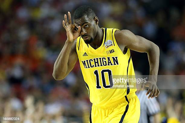 Tim Hardaway Jr #10 of the Michigan Wolverines reacts after he made a 3point shot in the second half against the Syracuse Orange during the 2013 NCAA...