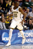 Tim Hardaway Jr #10 of the Michigan Wolverines reacts in the second half against the South Dakota State Jackrabbits during the second round of the...