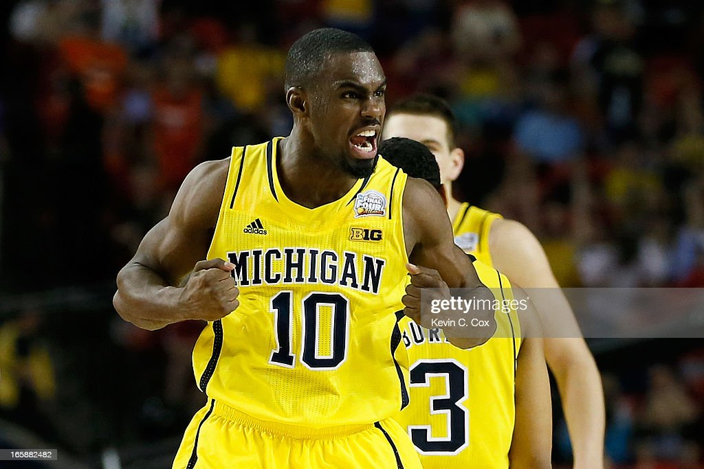 Tim Hardaway Jr. #10 of the Michigan Wolverines reacts in the second half against the Syracuse Orange during the 2013 NCAA Men's Final Four Semifinal at the Georgia Dome on April 6, 2013 in Atlanta, Georgia.