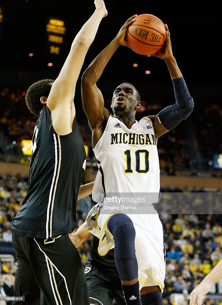 Tim Hardaway Jr. #10 of the Michigan Wolverines tries to get a first half shot off against A.J. Hammons #20 of the Purdue Boilermakers at Crisler Center on January 24, 2013 in Ann Arbor, Michigan.