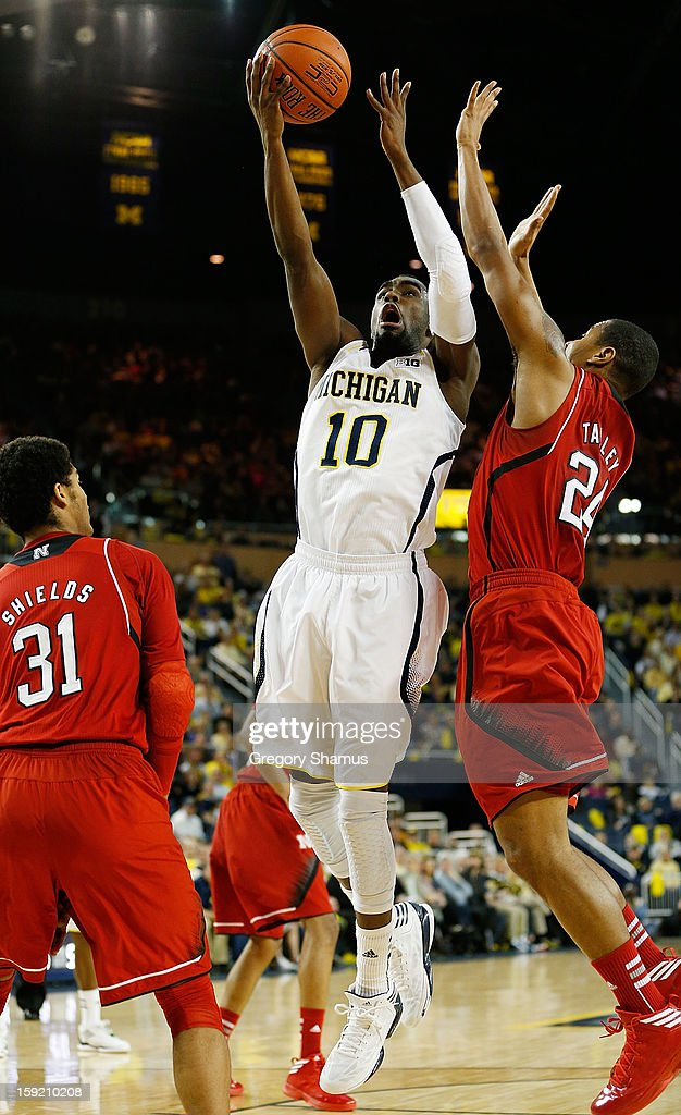 Tim Hardaway Jr. #10 of the Michigan Wolverines tries to get to the basket past Dylan Talley #24 of the Nebraska Cornhuskers during the first half at Crisler Center on January 9, 2013 in Ann Arbor, Michigan.