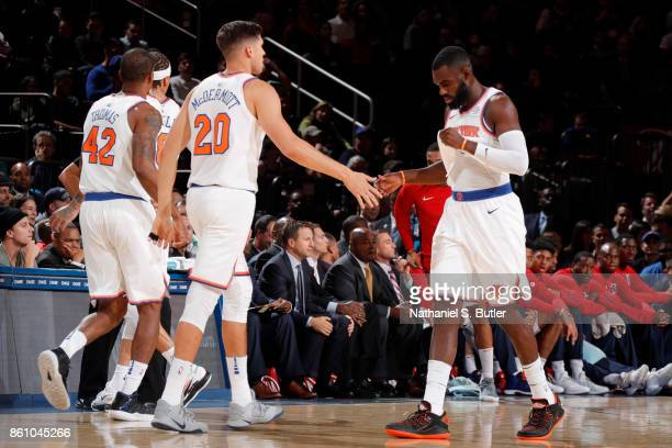 Tim Hardaway Jr #3 and Doug McDermott of the New York Knicks high five during the game against the Washington Wizards on October 13 2017 at Madison...