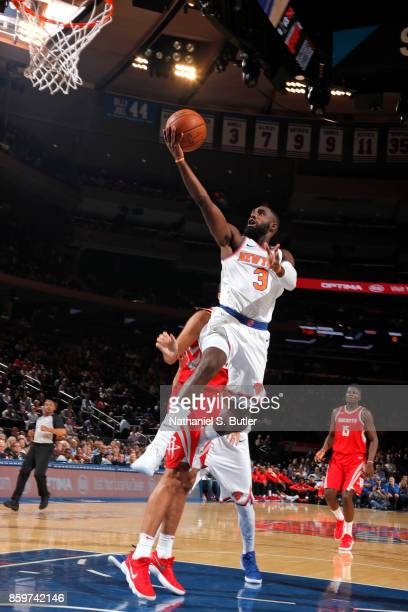 Tim Hardaway Jr #3 of the New York Knicks drives to the basket against the Houston Rockets handles the ball against the Houston Rockets during the...
