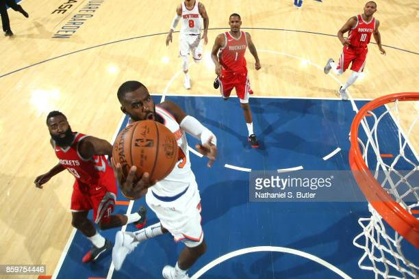 Tim Hardaway Jr #3 of the New York Knicks drives to the basket against the Houston Rockets during the preseason game on October 9 2017 at Madison...