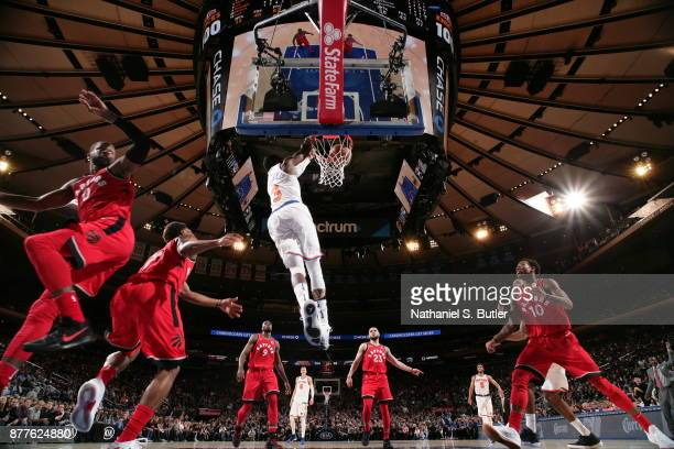 Tim Hardaway Jr #3 of the New York Knicks dunks the ball during the game against the Toronto Raptors on November 22 2017 at Madison Square Garden in...