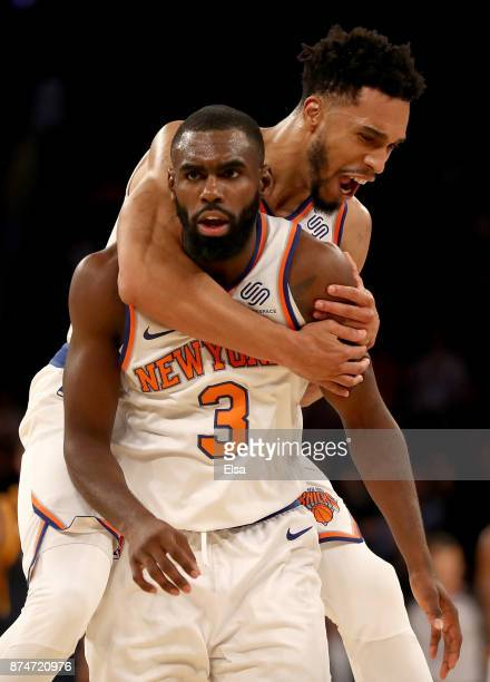 Tim Hardaway Jr #3 of the New York Knicks is congratulated by teammate Courtney Lee after Hardaway Jr hit a three point shot in the final minutes of...