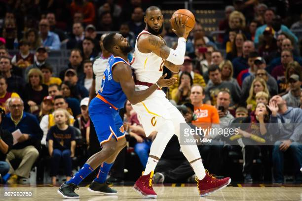 Tim Hardaway Jr #3 of the New York Knicks puts pressure on LeBron James of the Cleveland Cavaliers during the first half at Quicken Loans Arena on...
