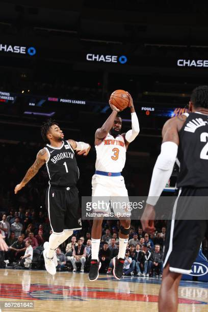 Tim Hardaway Jr #3 of the New York Knicks shoots the ball against D'Angelo Russell of the Brooklyn Nets during the preseason game on October 3 2017...