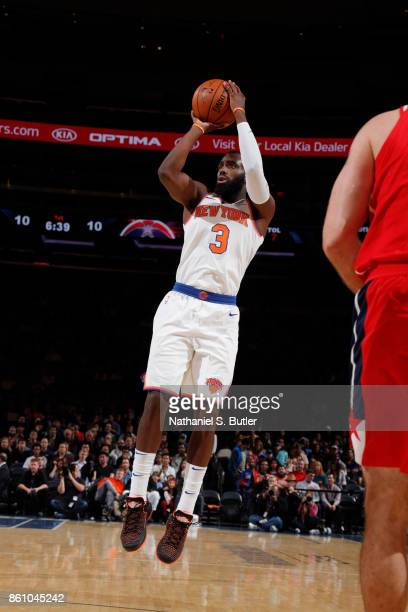 Tim Hardaway Jr #3 of the New York Knicks shoots the ball against the Washington Wizards on October 13 2017 at Madison Square Garden in New York City...