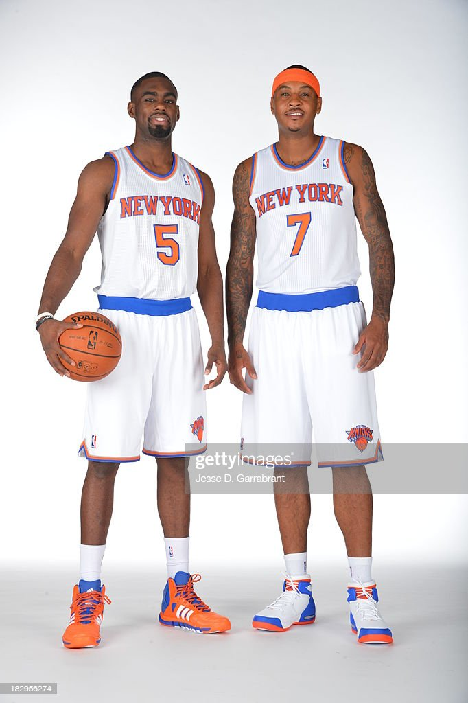 Tim Hardaway Jr. #5 and Carmelo Anthony #7 of the New York Knicks pose for a portrait at Media Day on September 30, 2013 at Madison Square Garden in New York City, New York.