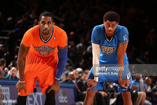 Tim Hardaway Jr #5 of the New York Knicks and Jeremy Lamb of the Oklahoma City Thunder stand on the court during a game at Madison Square Garden in...