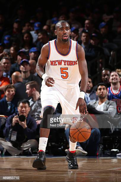 Tim Hardaway Jr #5 of the New York Knicks brings the ball up court against the Detroit Pistons on April 15 2015 at Madison Square Garden in New York...
