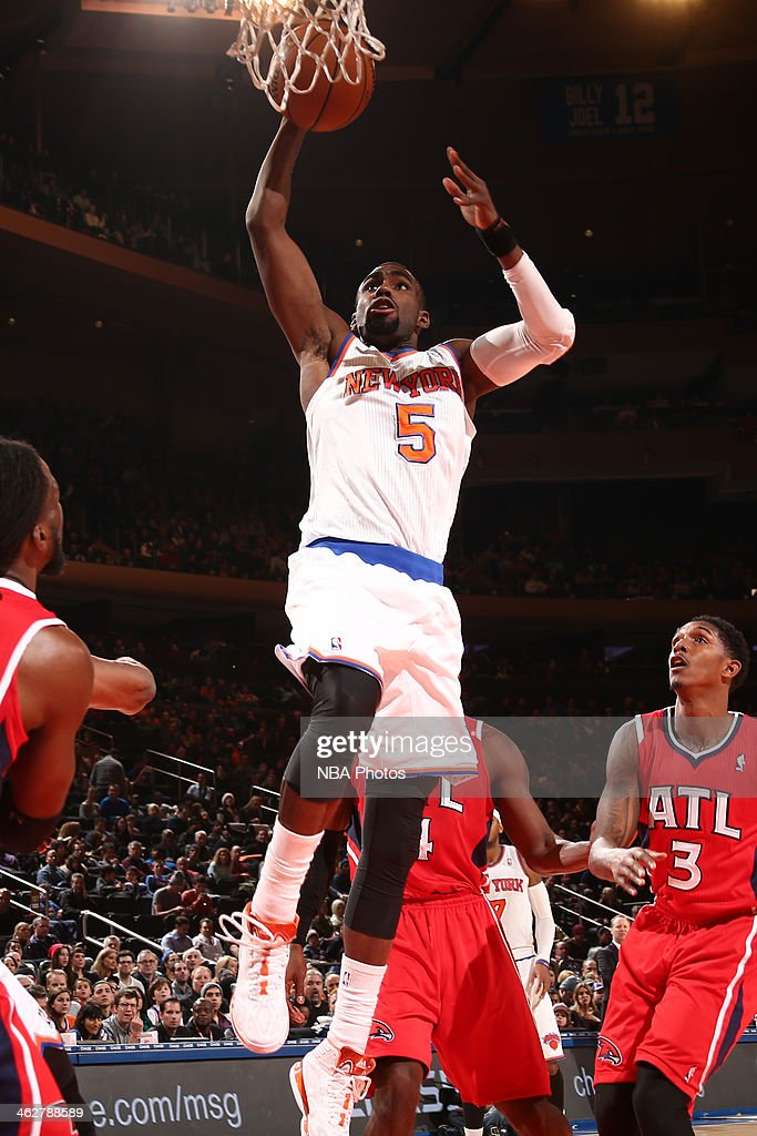 Tim Hardaway Jr. #5 of the New York Knicks drives to the basket against the Atlanta Hawks during a game at Madison Square Garden in New York City.