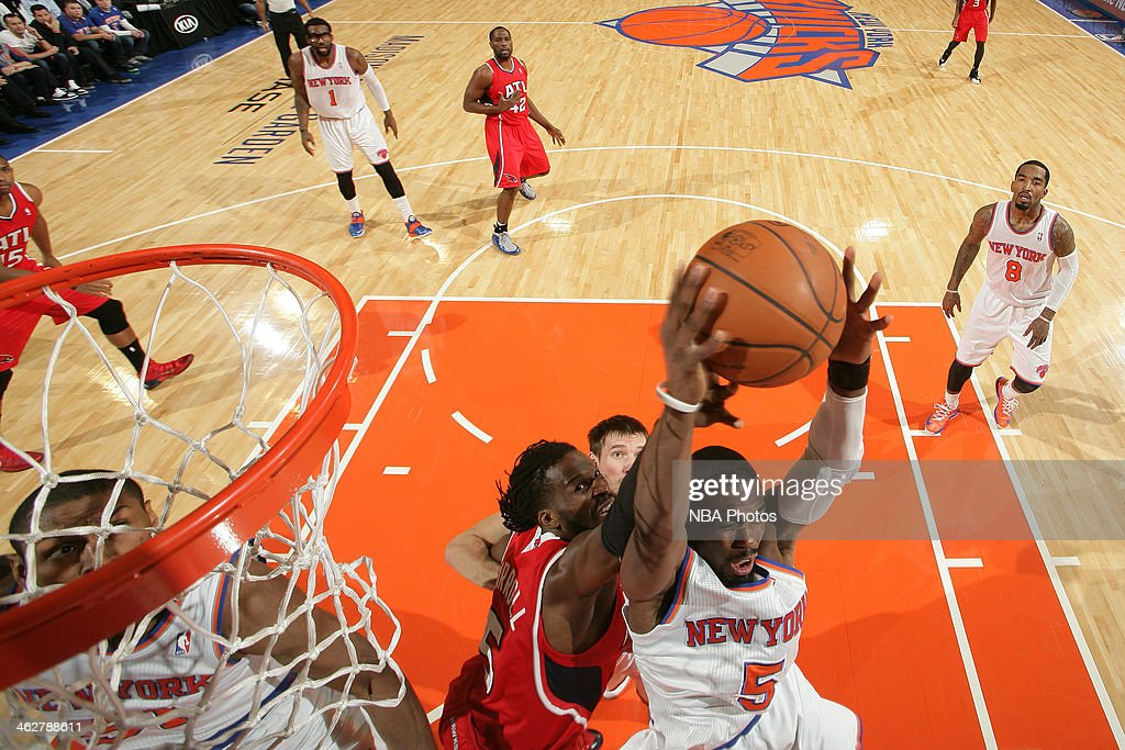 Tim Hardaway Jr. #5 of the New York Knicks grabs a rebound against the Atlanta Hawks during a game at Madison Square Garden in New York City.