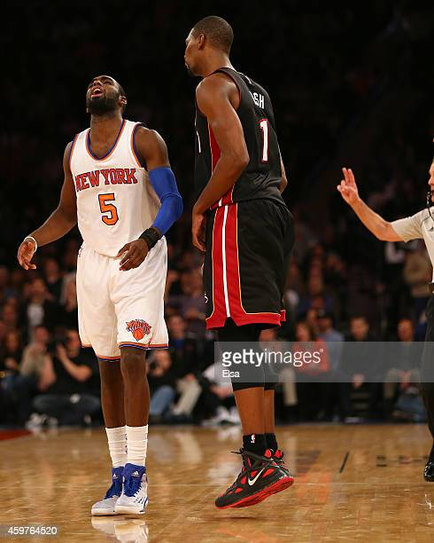 Tim Hardaway Jr #5 of the New York Knicks reacts after Chris Bosh of the Miami Heat hit a shot in the fourth quarter at Madison Square Garden on...