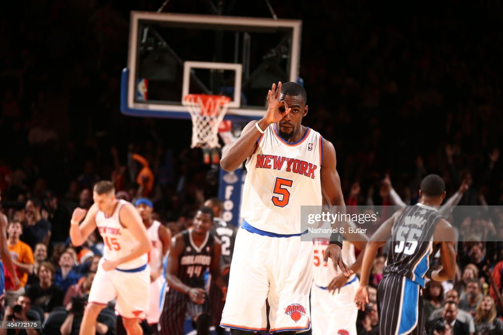 Tim Hardaway Jr. #5 of the New York Knicks reacts after hitting a three-point shot during a game against the Orlando Magic at Madison Square Garden in New York City on December 6, 2013.