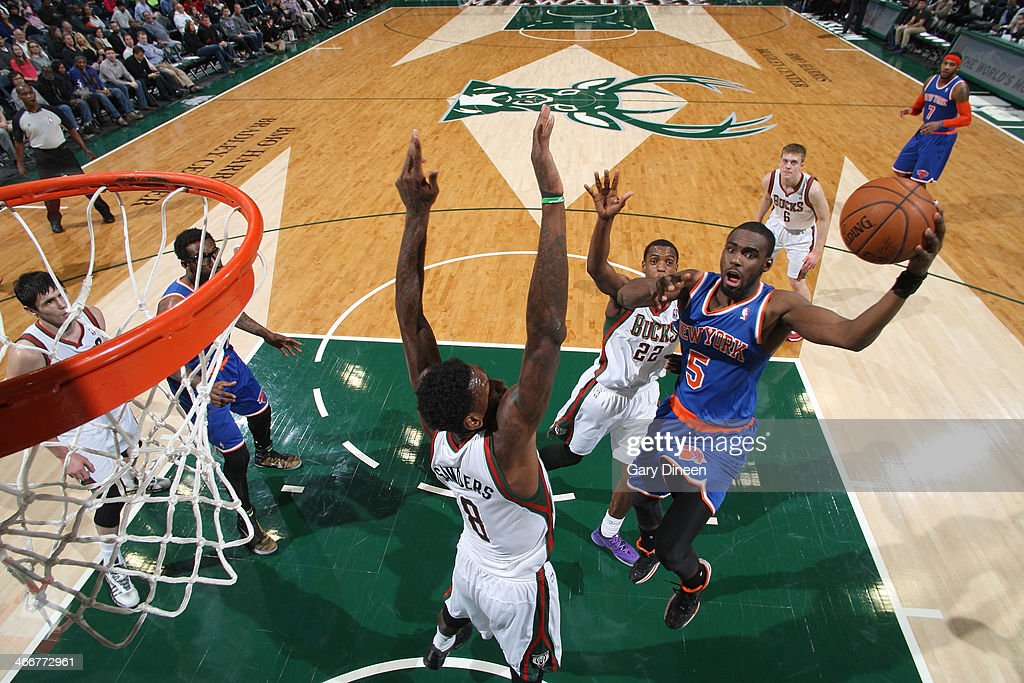 Tim Hardaway Jr. #5 of the New York Knicks shoots against (L-R) Larry Sanders #8 and Khris Middleton #22 of the Milwaukee Bucks on February 3, 2014 at the BMO Harris Bradley Center in Milwaukee, Wisconsin.