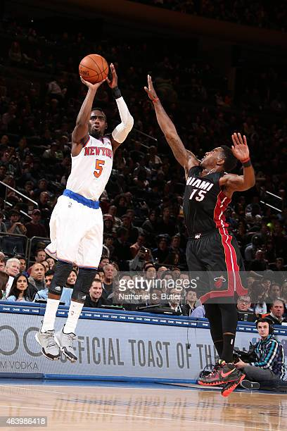 Tim Hardaway Jr #5 of the New York Knicks shoots against Mario Chalmers of the Miami Heat on February 20 2015 at Madison Square Garden in New York...