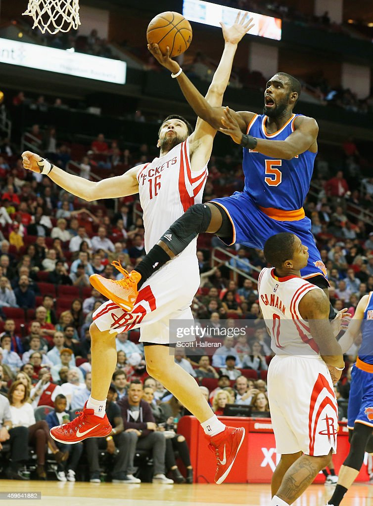 <a gi-track='captionPersonalityLinkClicked' href=/galleries/search?phrase=Tim+Hardaway+Jr.&family=editorial&specificpeople=7481128 ng-click='$event.stopPropagation()'>Tim Hardaway Jr.</a> #5 of the New York Knicks takes a shot over <a gi-track='captionPersonalityLinkClicked' href=/galleries/search?phrase=Kostas+Papanikolaou&family=editorial&specificpeople=5969202 ng-click='$event.stopPropagation()'>Kostas Papanikolaou</a> #16 and <a gi-track='captionPersonalityLinkClicked' href=/galleries/search?phrase=Isaiah+Canaan&family=editorial&specificpeople=6846224 ng-click='$event.stopPropagation()'>Isaiah Canaan</a> #0 of the Houston Rockets at the Toyota Center on November 24, 2014 in Houston, Texas.
