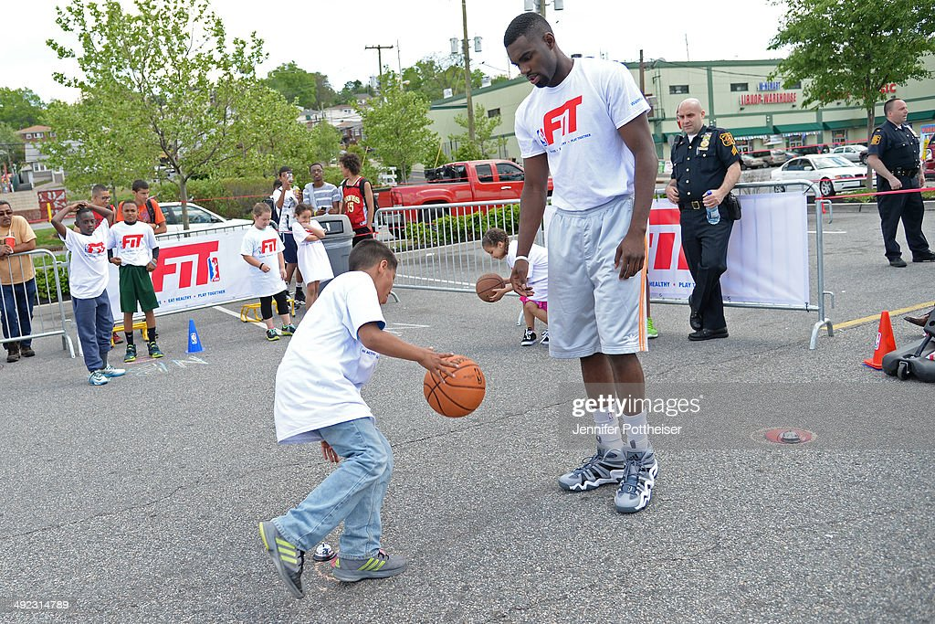 Tim Hardaway Jr. #5 of the New York Knicks takes part in an NBA Fit Clinic at Walmart on May 17, 2014 in North Bergen, New Jersey.
