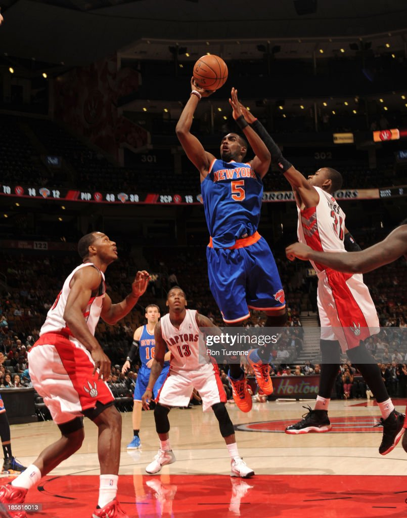 Tim Hardaway Jr #5 of the New York Knicks shoots the ball against the Toronto Raptors during the game on October 21, 2013 at the Air Canada Centre in Toronto, Ontario, Canada.