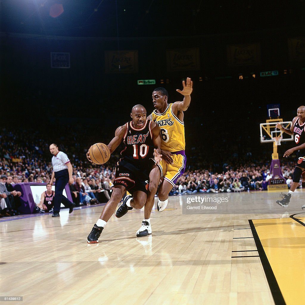Tim Hardaway of the Miami Heat drives to the basket against the Los Angeles Lakers during an NBA game in 1998 at Great Western Forum in Inglewood...