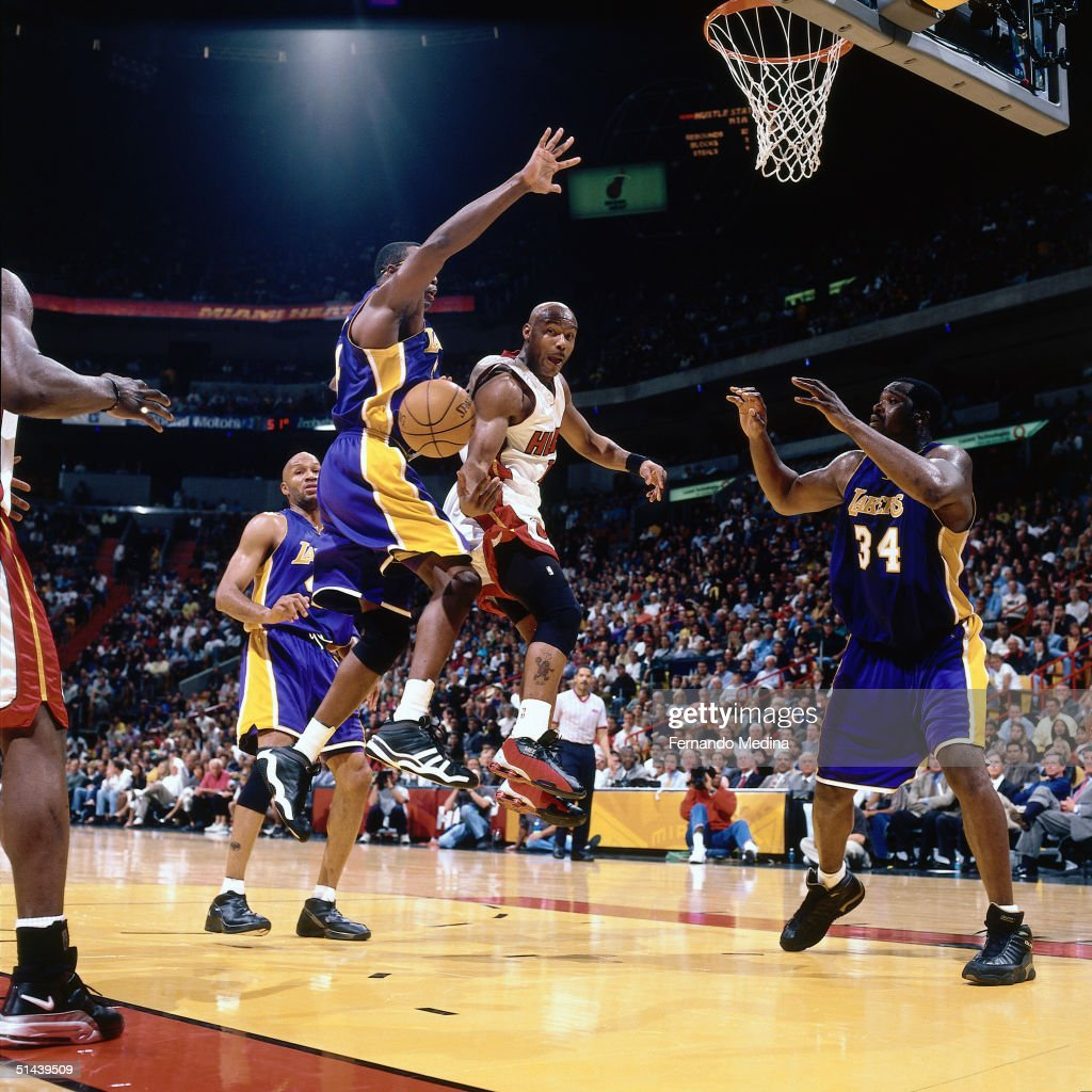Tim Hardaway the Miami Heat drives to the basket and passes behind his back against Los Angeles Lakers during an NBA game in 2001 at the American...