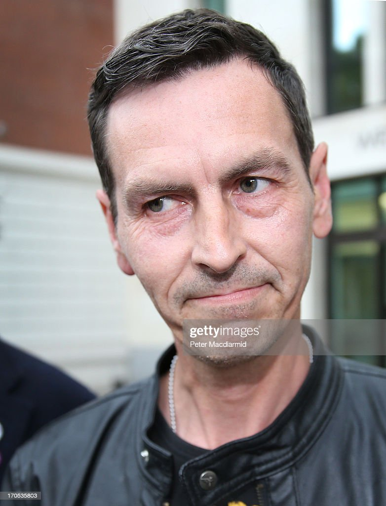 Tim Haries (C) leaves Westminster Magistrates Court on June 14, 2013 in London, England. Mr Haries has pleaded not guilty to causing more than £5,000 worth of damage to a painting of Queen Elizabeth II which was defaced with spray paint as it hung in Westminster Abbey on June 13, 2013.