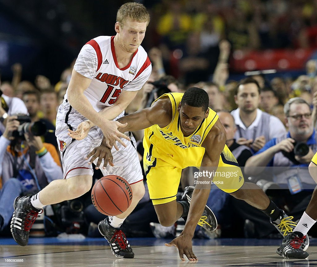 Tim Henderson #15 of the Louisville Cardinals and Glenn Robinson III #1 of the Michigan Wolverines go after a loose ball in the first half during the 2013 NCAA Men's Final Four Championship at the Georgia Dome on April 8, 2013 in Atlanta, Georgia.