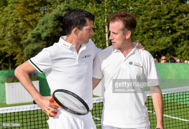 Tim Henman and Anton du Beke pose for pictures during a tennis lesson to promote HSBC's sponsorship of Wimbledon on HSBC Court 20 at the All England...