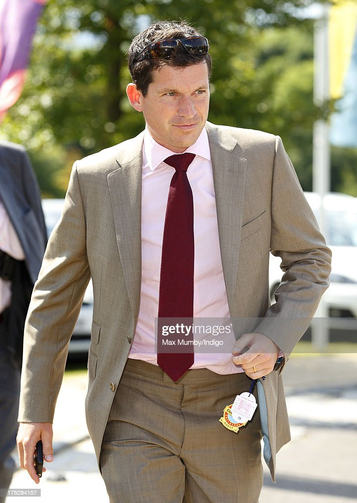 <a gi-track='captionPersonalityLinkClicked' href=/galleries/search?phrase=Tim+Henman&family=editorial&specificpeople=167277 ng-click='$event.stopPropagation()'>Tim Henman</a> attends Ladies Day of Glorious Goodwood at Goodwood Racecourse on August 1, 2013 in Chichester, England.