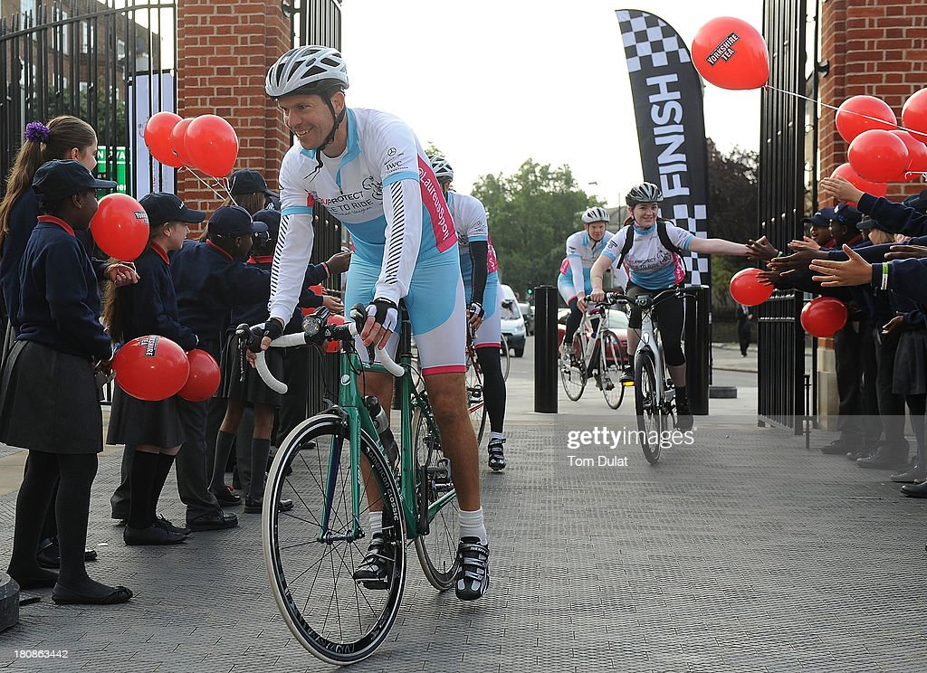 <a gi-track='captionPersonalityLinkClicked' href=/galleries/search?phrase=Tim+Henman&family=editorial&specificpeople=167277 ng-click='$event.stopPropagation()'>Tim Henman</a> crosses the finish line during the Laureus PruProtect Chance to Ride at Kia Oval on September 17, 2013 in London, England. Michael Vaughan is leading a host of stars and fundraisers on the event, which will raise funds for the Laureus Sport for Good Foundation and the Cricket Foundation's Chance to Shine initiative.