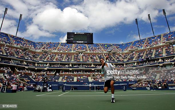 Tim Henman of Britain chases down a lob by Nicolas Kiefer of Germany during their fourth round match in Arthur Ashe Stadium at the US Open...