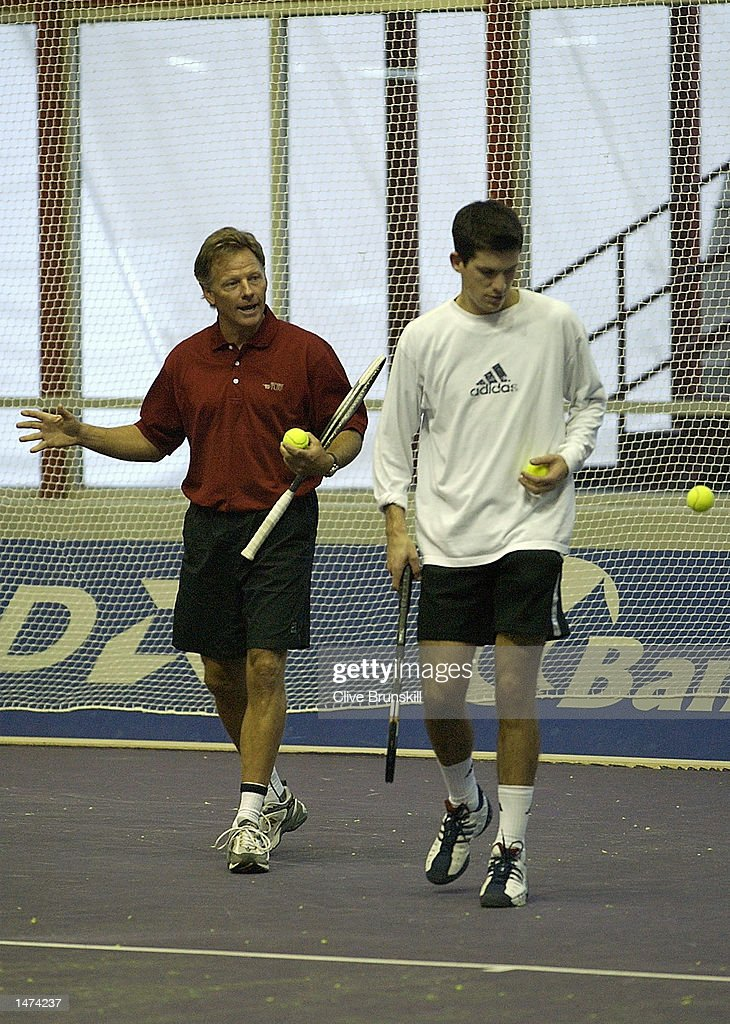 Tim Henman of Great Britain during a training session with his coach Larry Stefanki, whilst he waits for news from his wife Lucy, who is expecting the couples first child this week during the Tennis Masters Madrid at The Pabellon De Cristal, Madrid, Spain on October 14, 2002.