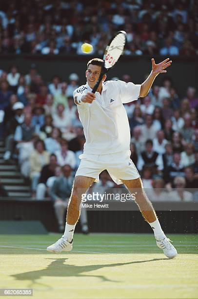 Tim Henman of Great Britain during his Men's Singles second round match of the Wimbledon Lawn Tennis Championship against Scott Draper on 27 June...