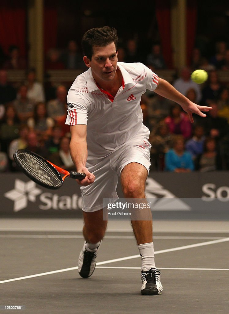 Tim Henman of Great Britain in action during the ATP Champions Tour Final between Tim Henman of Great Britain and Fabrice Santoro of France during the Statoil Masters Tennis at Royal Albert Hall on December 9, 2012 in London, England.