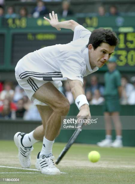 Tim Henman of Great Britain lost to Mario Ancic of Croatia in the quarter final 76 64 62 of the Wimbledon Championships in London Great Britain on...