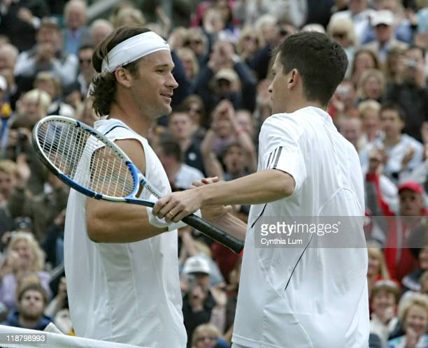 Tim Henman of Great Britain shakes hands with Carlos Moya after his 63 16 57 62 1311 victory in the first round of the 2007 Wimbledon Championships...