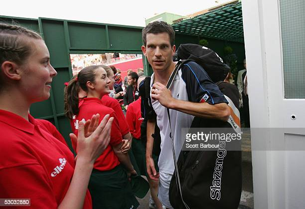 Tim Henman of Great Britan is applauded by ball girls after winning his first round match against Robby Ginepri of USA at the Stella Artois Tennis...