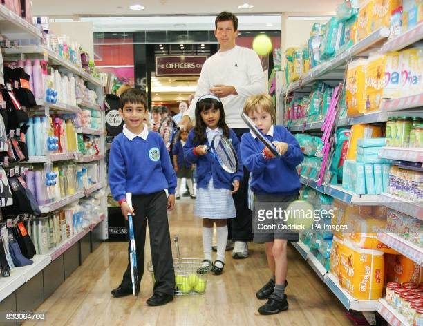 Tim Henman practices with Hassam Mahfouz Jasmine Ram and Tom Craddock from local school Dundonald Primary during the launch of a new competition at...