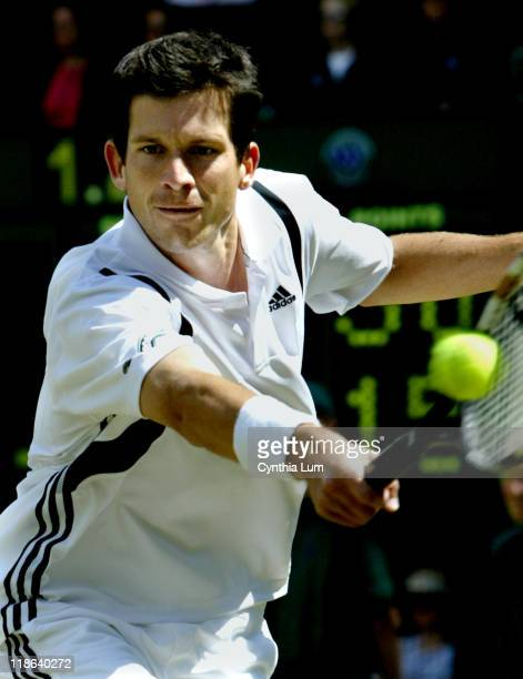 Tim Henman through to the third round at the Wimbledon Championships defeating Ivo Heuberger 75 63 62