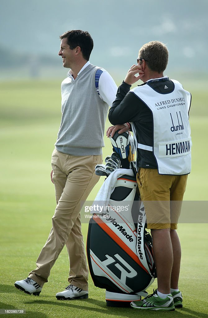 Tim Henman with his caddy during the third round of the Alfred Dunhill Links Championship on The Old Course, at St Andrews on September 28, 2013 in St Andrews, Scotland.