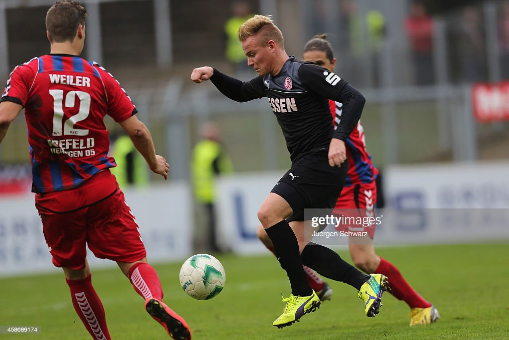 Tim Hermes of Essen (C) controls the ball during the Regionalliga West match between KFC Uerdingen and Rot-Weiss Essen on November 9, 2014 in Krefeld, Germany.