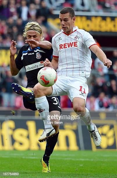 Tim Heubach of Frankfurt challenges Thomas Broeker of Koeln during the Second Bundesliga match betweeen 1 FC Koeln and FSV Frankfurt at...