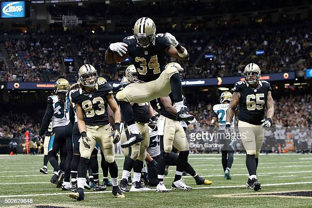 Tim Hightower of the New Orleans Saints celebrates a touchdown during the second half of a game against the Jacksonville Jaguars at the MercedesBenz...