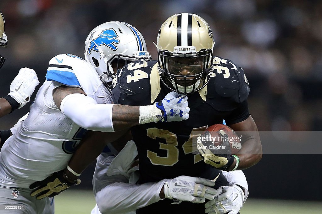 Tim Hightower #34 of the New Orleans Saints is brought down by Tahir Whitehead #59 of the Detroit Lions during the fourth quarter of a game at the Mercedes-Benz Superdome on December 21, 2015 in New Orleans, Louisiana.