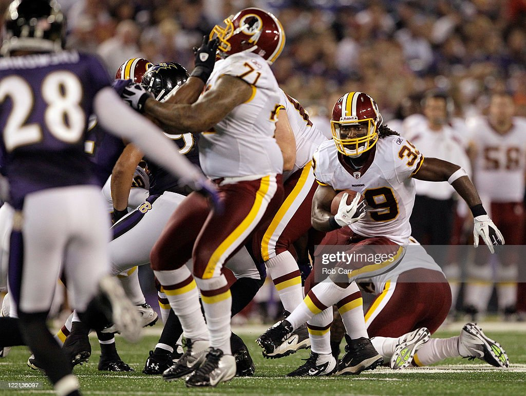 <a gi-track='captionPersonalityLinkClicked' href=/galleries/search?phrase=Tim+Hightower&family=editorial&specificpeople=5329794 ng-click='$event.stopPropagation()'>Tim Hightower</a> #39 of the Washington Redskins carries the ball for a touchdown against the Baltimore Ravens during the first half of a preseason game at M&T Bank Stadium on August 25, 2011 in Baltimore, Maryland.