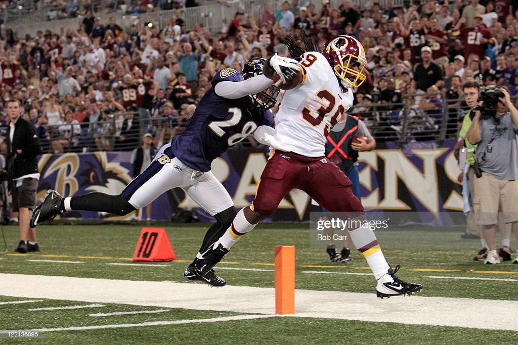 <a gi-track='captionPersonalityLinkClicked' href=/galleries/search?phrase=Tim+Hightower&family=editorial&specificpeople=5329794 ng-click='$event.stopPropagation()'>Tim Hightower</a> #39 of the Washington Redskins scores a touchdown against <a gi-track='captionPersonalityLinkClicked' href=/galleries/search?phrase=Tom+Zbikowski&family=editorial&specificpeople=572502 ng-click='$event.stopPropagation()'>Tom Zbikowski</a> #28 of the Baltimore Ravens during the first half of a preaseason game at M&T Bank Stadium on August 25, 2011 in Baltimore, Maryland.